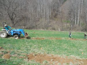 Anna and Greg raking the sod away from the planting holes